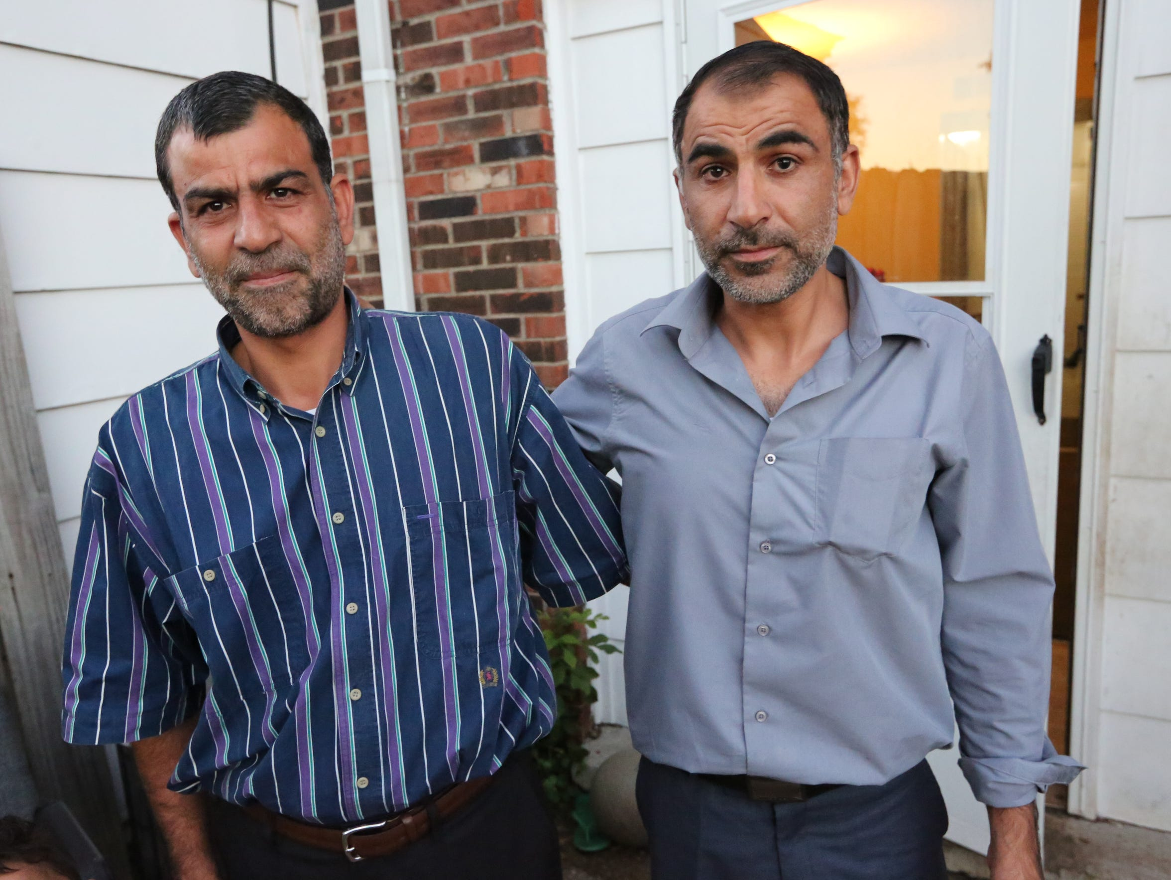Ahmad Al Tybawi, left, and his newly arrived brother,
