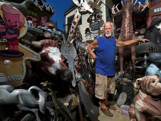 Jerry Lotz has been collecting unique antiques at his home on the corner of Frankfort Ave. and William St. for fifty-five years.  He is seen with some of his collection. Sept. 12, 2016.