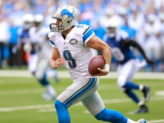 Lions quarterback Matthew Stafford (9) runs against the Colts during the first half Sunday.