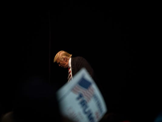 Donald Trump, the Republican presidential nominee, exits the stage after speaking at a campaign event at the Seven Flags Event Center in Clive, Iowa.