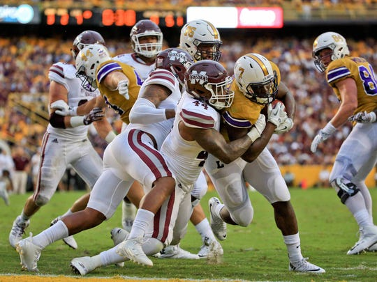 Sep 17, 2016; Baton Rouge, LA, USA;  LSU Tigers running back Leonard Fournette (7) runs for a touchdown against Mississippi State Bulldogs linebacker Leo Lewis (44) during the first quarter of a game at Tiger Stadium. Mandatory Credit: Derick E. Hingle-USA TODAY Sports