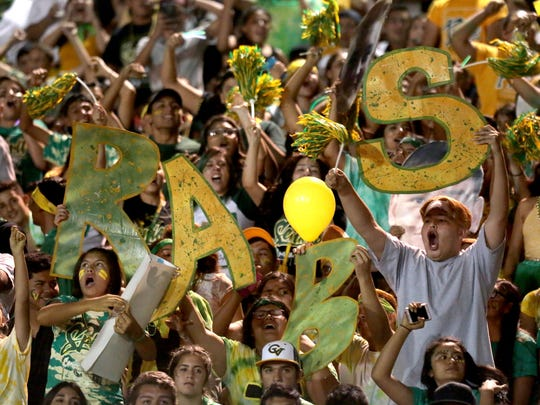 Coachella Valley fans cheer on their team during the Bell Game with Indio on Friday, September 16, 2016 in Thermal.