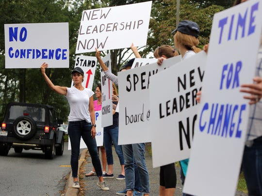"""Protester Jane Shepardson holds a """"No Confidence"""" sign at a Sept. 19, 2016, rally outside the Chappaqua school district's administration building, asking for new leadership after the way Superintendent Lyn McKay handled the sex-abuse case of former teacher Christopher Schraufnagel."""