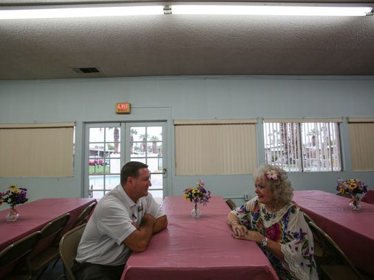 Jim Curtis the community services manager for the City of Indio talks with Marguerite Kaczmarski the property manager at the La Quinta Ridge mobile home park about the upcoming Desert Trip concert weekends that'll be held at the Empire Polo Club located just behind La Quinta Ridge. The City Indio is doing outreach to hear neighbors of the concert venus about their concerns. Photo taken on Tuesday, September 20, 2016 in Indio.