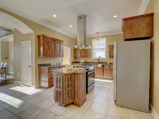 The large kitchen and keeping area overlooks the outdoor