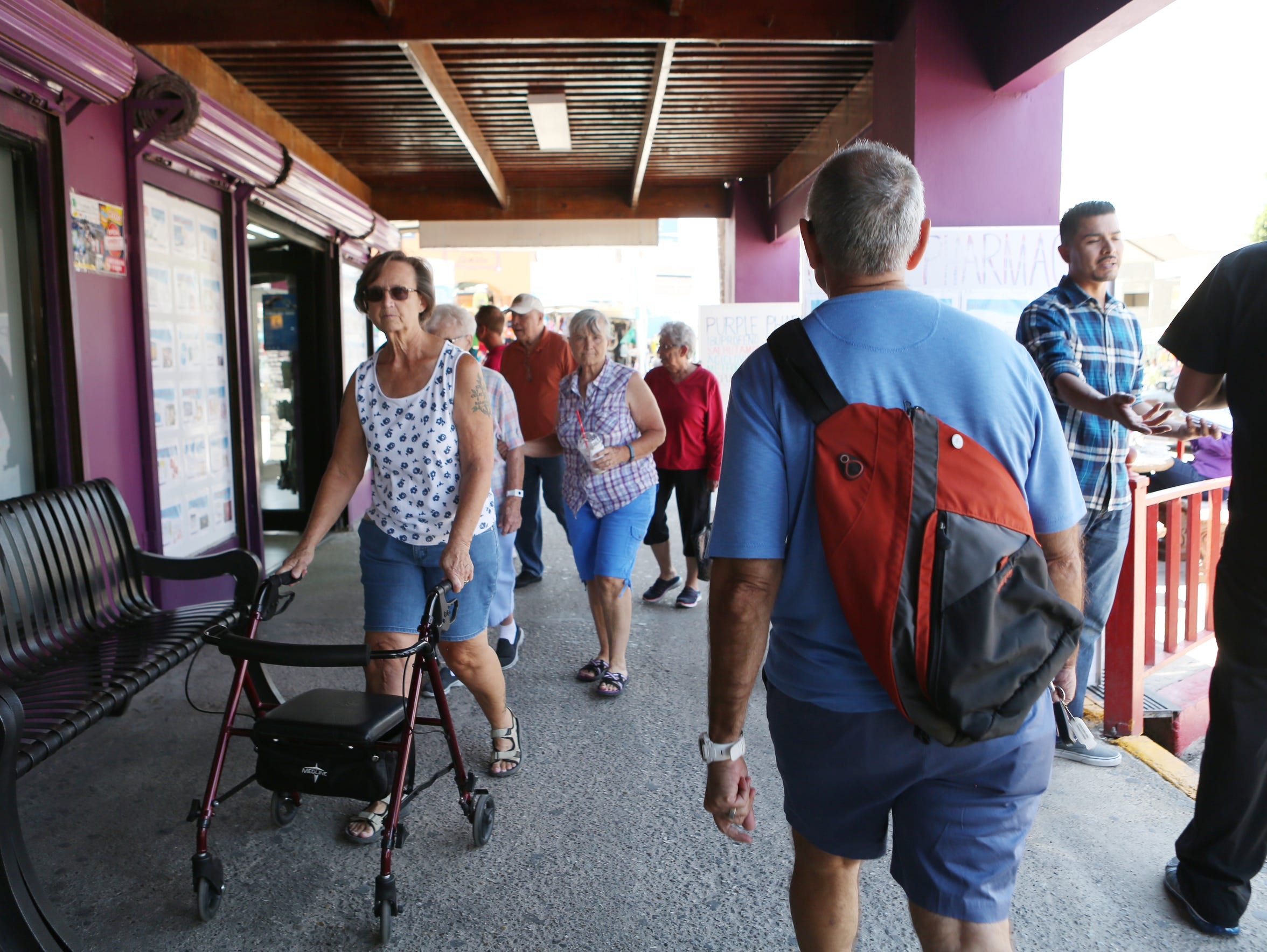 Palm Springs resident Vic Yepello walks through a busy