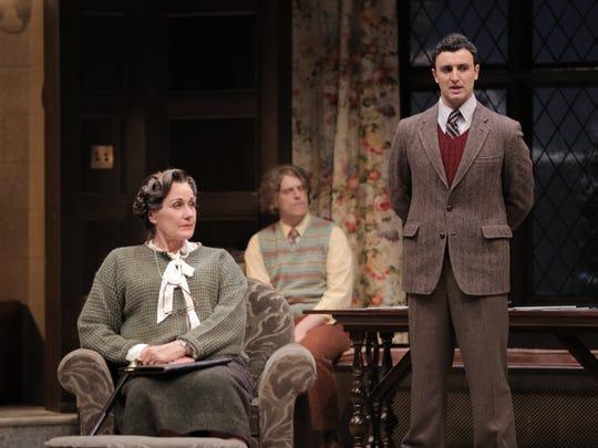 "Detective Sergeant Trotter (Lowell Byers) questions the wonderfully whiny Mrs. Boyle (Diana Van Fossen) as architect Christopher Wren (Loren Dunn) listens in ASF's ""The Mousetrap."""