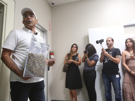 Canndescent, a newly opened production plant in Desert Hot Springs, will be able to produce 2500 pounds of product monthly for the medicinal market. The high end product could also be destine for recreational use if Proposition 64 passes in the November presidential elections. In this photo, CEO Adrian Sadlin holds a bag with trimmed marijuana.