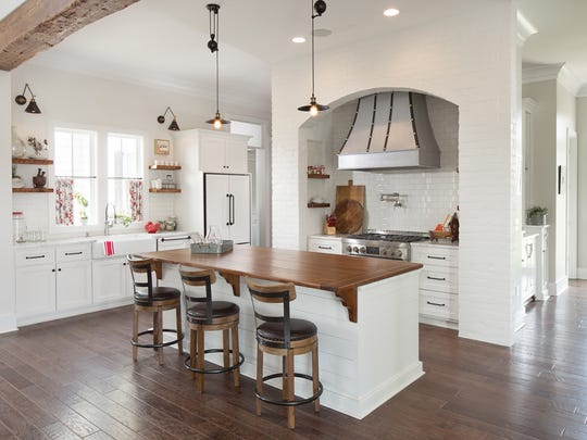 The kitchen is bright and open to other areas of the home.