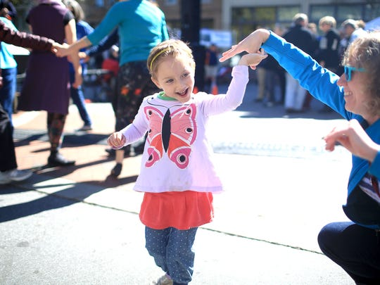 Noe Chasse dances with her mother during the HardLox Jewish food festival in 2014.