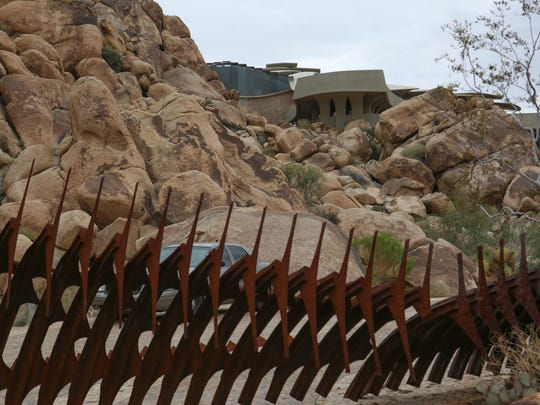 A highly stylized home tucked into the boulders near the entrance to Joshua Tree National Park, September 27, 2016.