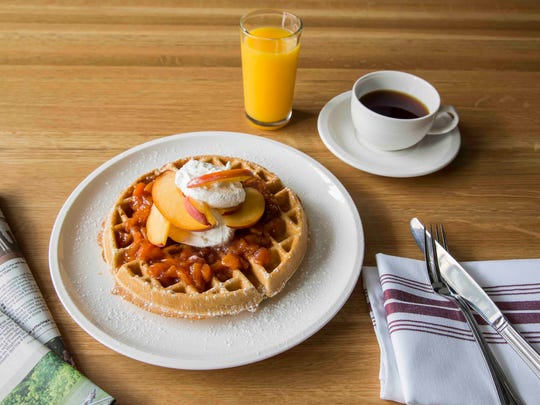 Peaches and cream waffle is one of the brunch plates served on Saturdays and Sundays at Tre Rivali in the Kimpton Journeyman hotel, 200 N. Broadway at E. Chicago St.