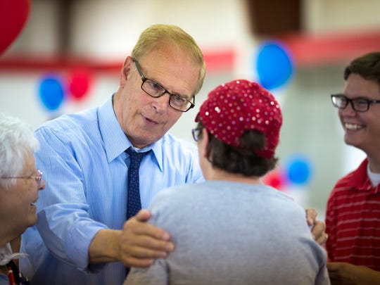 Doris Syroney Wilson greets Ted Strickland at his Sept. 10 fundraising event at the Scioto County Fairgrounds, near the place where he grew up. Wilson remembers Strickland as her senior class president at Northwest High School in southern Ohio.