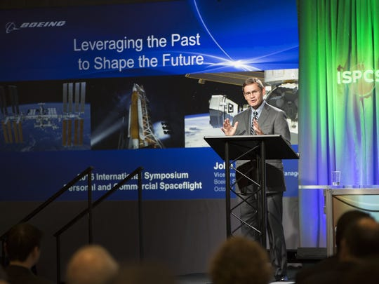 "Keynote speaker John Elbon, vice president and general manager of space exploration with The Boeing Company, speaks about ""Leaving the Past to Shape the Future"" on Wednesday, October 12, 2016, during the International Symposium for Personal and Commercial Spaceflight at the New Mexico Farm and Ranch Heritage Museum."