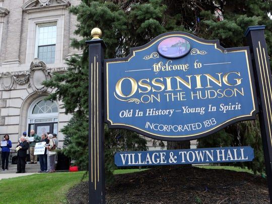 Community organizers and religious leaders hold a rally outside Ossining Village Hall Thursday.