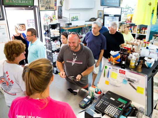 During the first day of stone crab season, droves of customers fill the market waiting for the day's catch at Kirk Fish Company and Fresh Seafood Market on Saturday, Oct. 15, 2016, in Goodland, Fla.