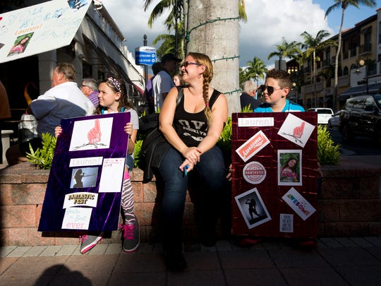 Lizette Froloff, center, and her two children Lizie, 9, and John, 13, show their support for Lauren Major while waiting for her to make her grand entrance into the Sugden Theatre before her sold-out concert performance Sunday, Oct. 16, 2016, in Naples. Lauren was diagnosed with Crohn's disease at an early age, and with the help of the Make-A-Wish Foundation of Southern Florida her wish, to become a singer, came true.
