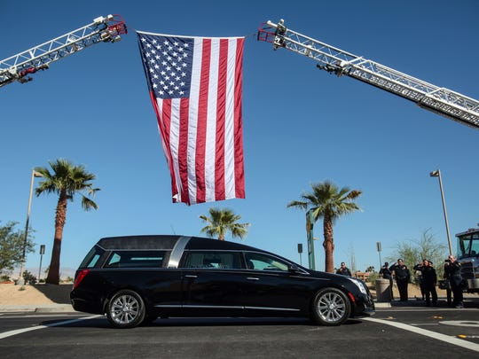 "A hearse carrying the body of fallen Palm Springs Police Officer Jose ""Gil"" Vega transports him from his memorial at the Palm Springs Convention Center to his funeral on Tuesday, October 18, 2016 in Palm Springs."