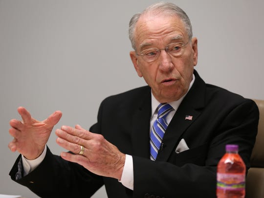 U.S. Senator Chuck Grassley talks with the Des Moines