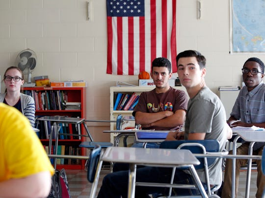 Seniors Katie Flanagan, Alonso Delgado, Mike McPadden and Stephane Mekontchov listen to a classmate during a discussion on the third presidential debate in an American Civics class at Nanuet High School Oct. 20, 2016.