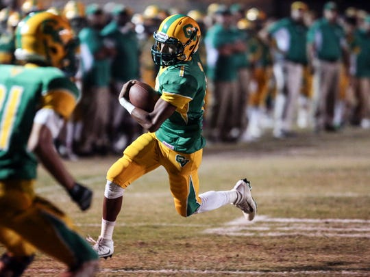 Coachella Valley quarterback Armando Deniz runs the ball for a touchdown against Desert Hot Springs in the 1st quarter on Friday, October 21, 2016 in Thermal