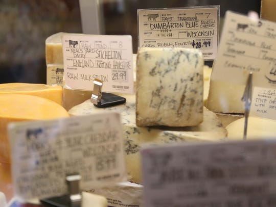 A variety of cheese on display at The Cheese Shop.