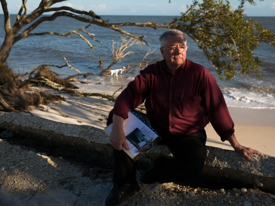 Tallahassee resident Bert Boldt sits on what's left of a driveway that once led to his Alligator Point vacation home, which was damaged in Hurricane Dennis and could not be rebuilt because of erosion.