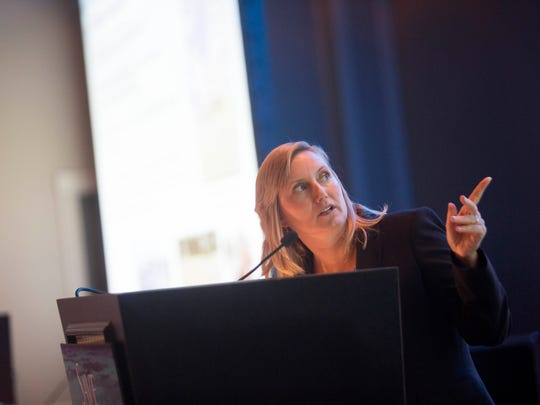Jennifer Hecker, Director of Natural Resource Policy at Conservancy of Southwest Florida speaks at the Save our Water Summit at Sanibel Harbour Marriot Resort & Spa on Wednesday.