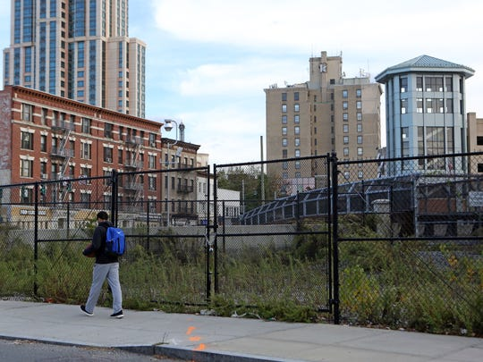 The fenced in area that will become a small park near the train station in downtown New Rochelle.
