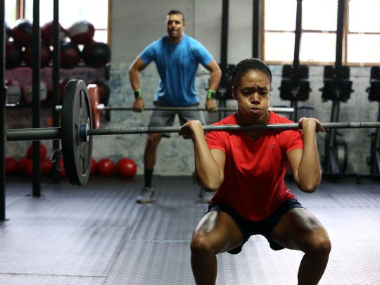 Antigone Lowery, 26, right, of Nyack and Christian Mendez of West Haverstraw, 27, during a workout at CrossFit Momentum in Nyack, Oct. 25, 2016.
