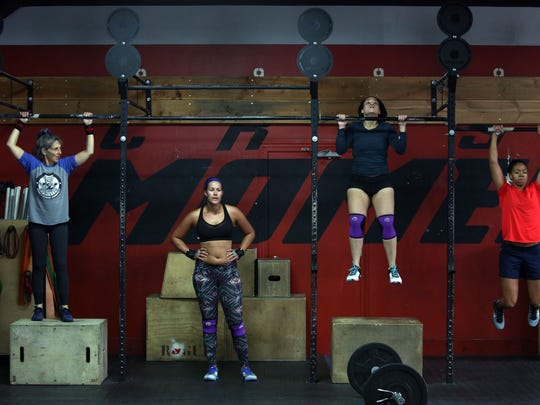 Loni Ackerman Kennedy, 67, Jordan Bradfield, 23, Megan Chan Meinero, 25, and Antigone Lowery, 26, during a workout at CrossFit Momentum in Nyack, Oct. 25, 2016. Ackerman Kennedy, a former dancer, has been doing CrossFit for two years and says she loves the workout because it is parallel to a great dance class.
