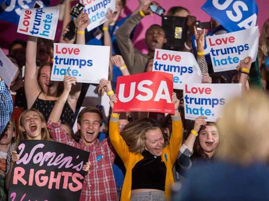 Roosevelt High School students cheer as Democratic presidential candidate Hillary Clinton campaigns at Roosevelt High School in Des Moines, Iowa, Friday Oct 28, 2016.