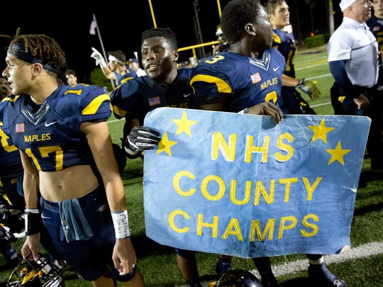 Naples' players celebrate after defeating Barron Collier, 42-14, at Naples High School Friday, October 28, 2016 in Naples. The Class 6A-District 12 champs secured home field advantage for the first round of the playoffs with the win.