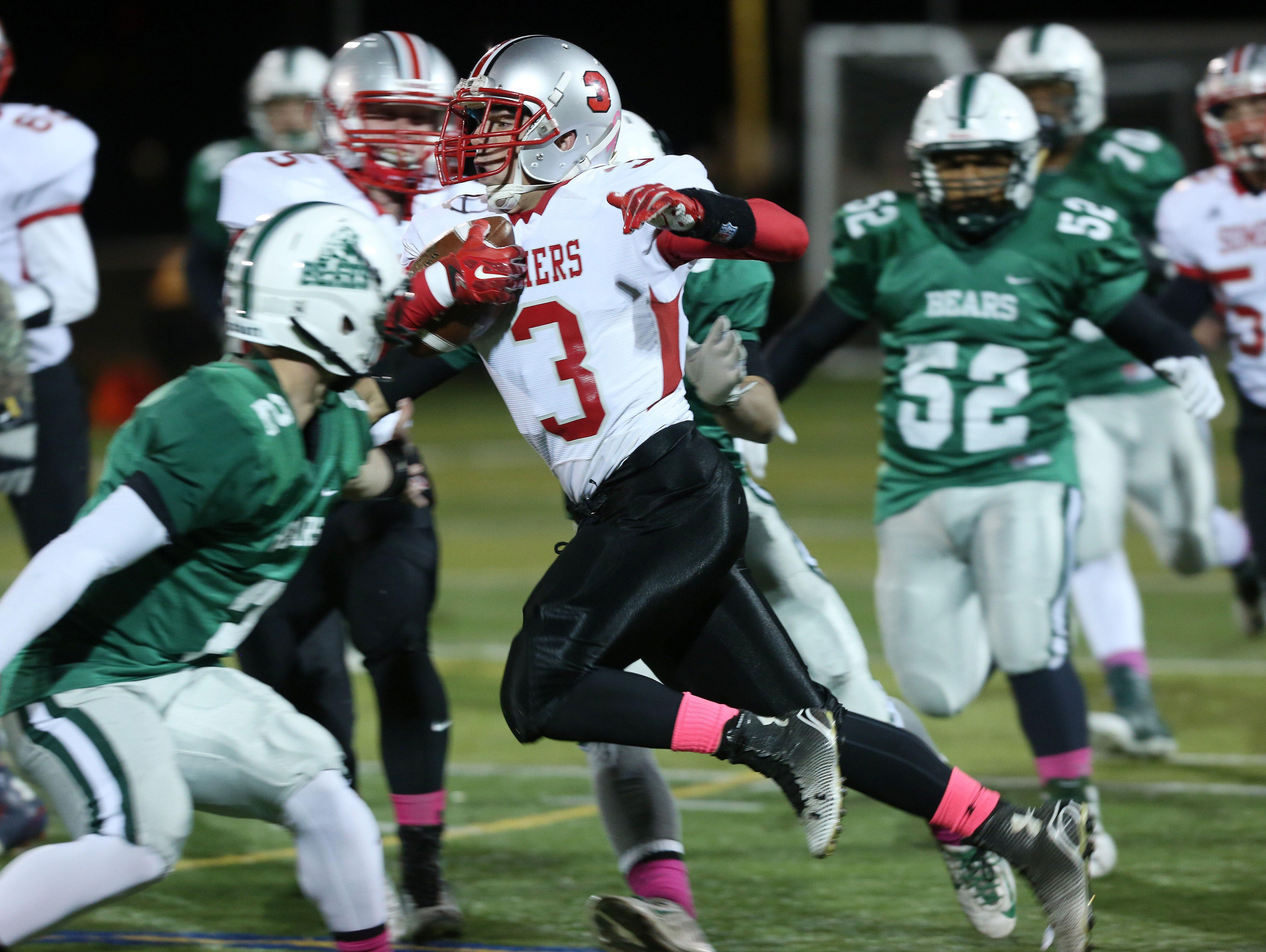 Somers' Matthew Pires (3) runs for a 66-yard touchdown on the first play from scrimmage against Brewster during the Section 1 Class A semifinals at Brewster High School Oct. 28, 2016.