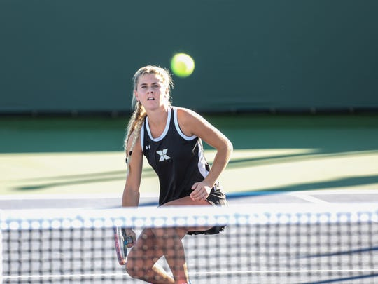 Xavier Prep doubles player Caroline Stack in action against Redlands at the Indian Wells Tennis Garden on Wednesday, November 2, 2016 in Indian Wells.