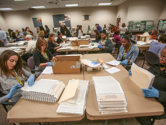 Elections workers at work at the County of Riverside Assessor County Clerk Recorder and Registrar of Voters office on Wednesday, November 1, 2016.