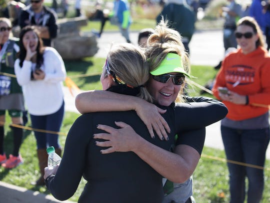 It was a sunny day for the Bass Pro Conservation Marathon and half-marathon Sunday, Nov. 6 2016. Kym Craft, right, hugs friend Robin Schilling at the finish. They both ran the half-marathon.