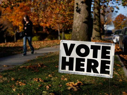 Voters arrive Tuesday, Nov. 8, 2016, to cast their