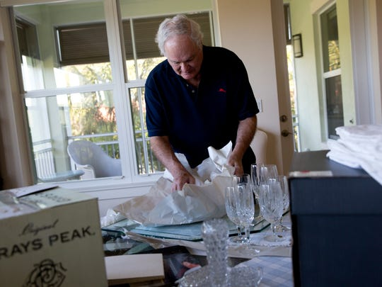 "Bob and Marilyn Mayer unpack their belongings in their new apartment at Vi at Bentley Village Wednesday, Nov. 9, 2016. The couple moved into their new apartment Friday, Nov. 4th. The couple was downsizing from a much larger home nearby. ""We looked at a number of places and this one met all of our needs,"" said Bob."