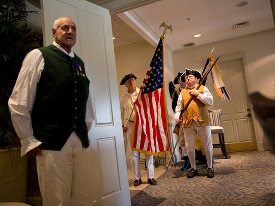 Historian for the Naples Chapter of the Sons of the American Revolution Don Cahill, left, introduces the color guard at the beginning of the Public Service Awards luncheon at The Club at Longshore Lake Thursday, Nov. 10, 2016 in Naples. The awards ceremony is a time to honor local police, firefighters, and EMS.