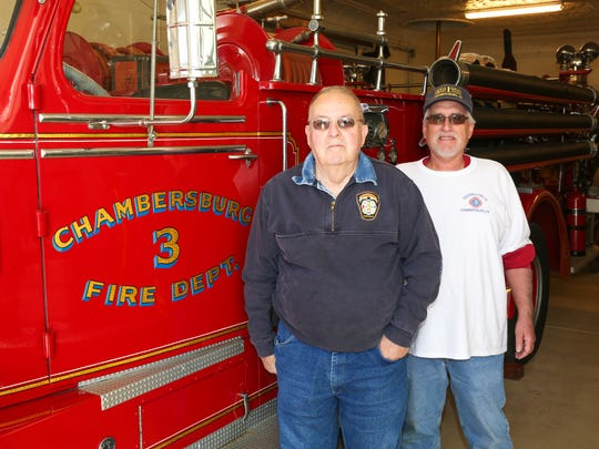 Larry Miley and Terry Shaffer pose with a Goodwill Fire Company truck.