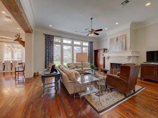 The living area and family room are open to the dining and kitchen area of the home.