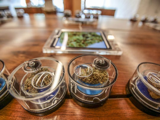 Clear containers allow customers to see and smell the 20 strains of marijuana offered at the MedMen marijuana dispensary on Santa Monica Blvd in West Hollywood. Tablets offer addition information. Photo taken on Tuesday, November 15, 2016.