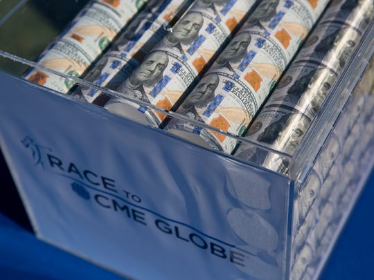 The winnings for the winner of the CME Group Tour Championship sit near the first tee box at Tiburon Golf Club Thursday, Nov. 17, 2016 in Naples.