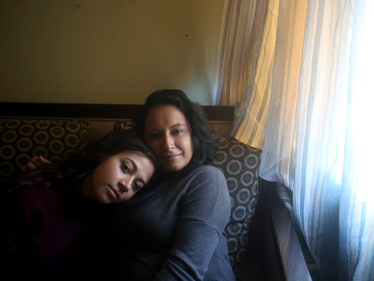 Pasqualina Gallo sits with her daughter Lourdes, 17,