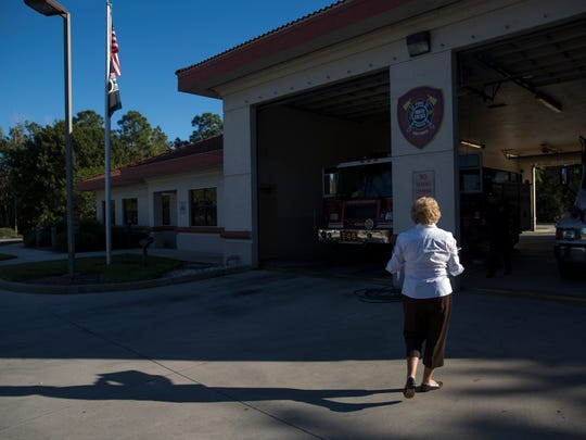 Bunny Brooks, a resident at the Regency Reserves in the Vineyards, approaches North Collier Fire Rescue Station No. 46 with a batch of homemade cookies Tuesday, Nov. 22, 2016, in Naples. Brooks, a member of the Collier County 100 Club, organized women in her community to bake cookies for local first responders as a way of thanking them for their service.