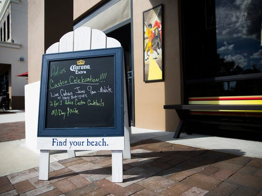 A sign outside of Fernandez the Bull Cuban Cafe advertises a two for one special on a drink called the 'Adios Castro' on Saturday, November 26, 2016 in North Naples.