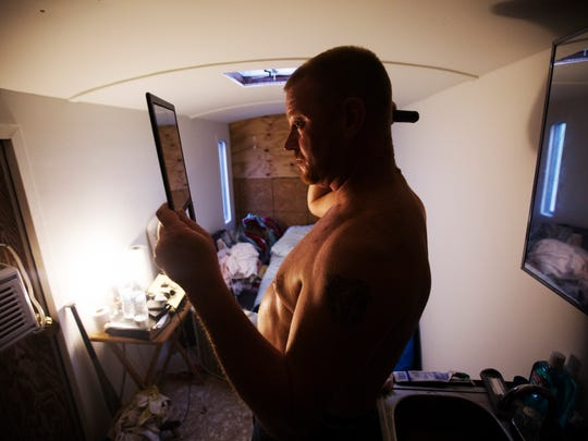 Drew Broderick cleans up in his construction trailer that he has converted into living quarters in North Fort Myers. Broderick, who works a construction job says rents are too high. He chooses to live a meager lifestyle so ha can make his own choices with the money he earns instead of it all going to bills.