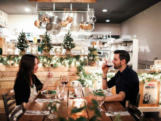 Customers at Rafns' Restaurant enjoy the warm ambiance while dining on locally sourced fare.