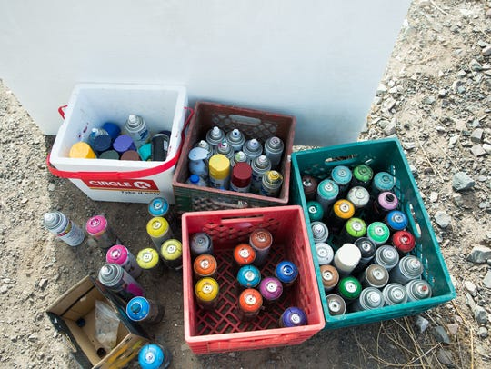 Traveling artist Yao Siao's boxes of spray paint, which